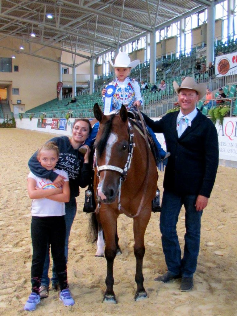 Anna with her daughters, trainer Mark Shaffer and her former horse Asset Machine. Anna's daughter Alice is wearing a custom designed vest by La Collezione di Anna; picture: LK